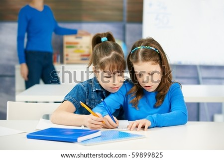 Children learning together in primary school classroom. Schoolgirls in elementary age.? - stock photo