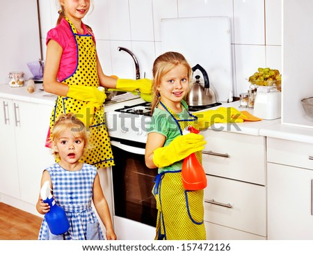 Children little girl cooking at kitchen. - stock photo