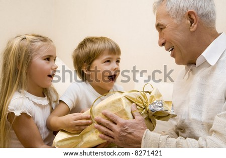 Children make a present to their grandpa - stock photo