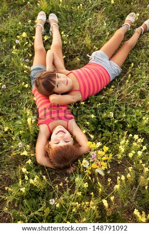 Children on a beautiful sunlit meadow in autumn - stock photo
