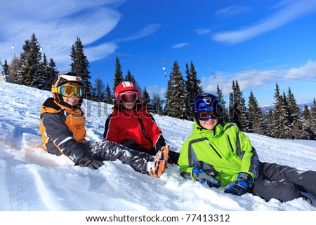 Children on a snowy slope - stock photo