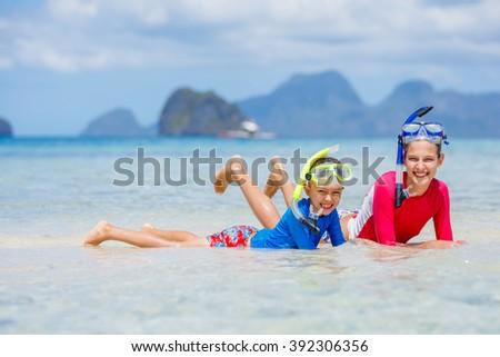 Children on beach - stock photo