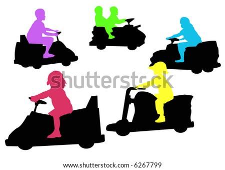 children on dodgem cars at fairground - stock photo