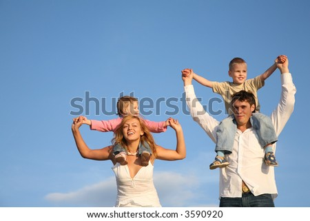 children on shoulders - stock photo
