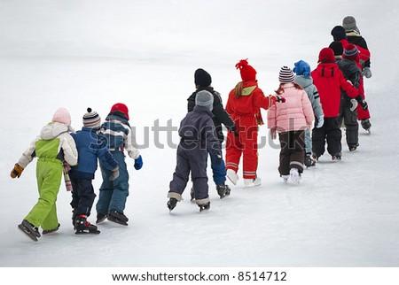 children on the ice - stock photo