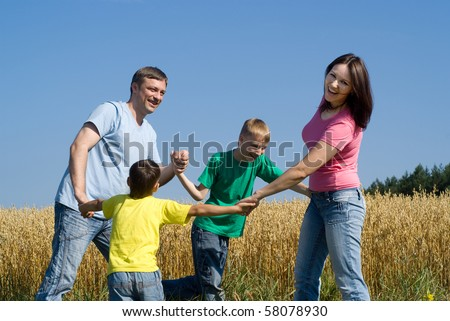 Children on the parents' backs - stock photo