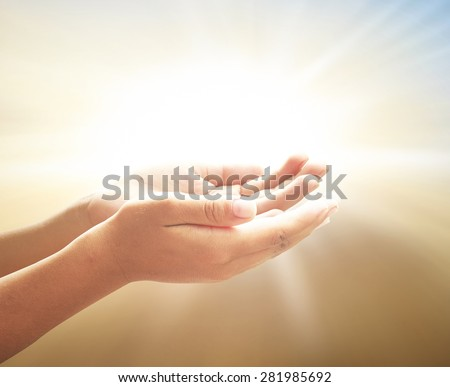 Children open empty hands with palms up over blurred beautiful bokeh light of sunset background. Vintage style. - stock photo