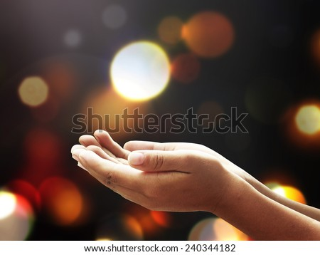 Children open empty hands with palms up over blurred beautiful bokeh of candle light background. World Mental Health Day, Repentance, Forgiveness, Mercy, Jews, Israel, Fire, Nine, religion concept. - stock photo