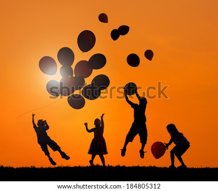 Children Outdoors Playing Balloons in Sunset - stock photo