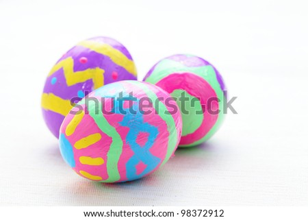 children paint colorful easter eggs - stock photo