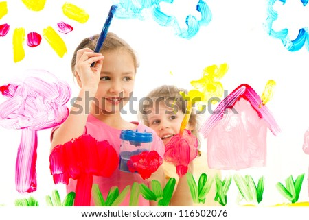 Children painting artwork on glass. Isolated on white. - stock photo