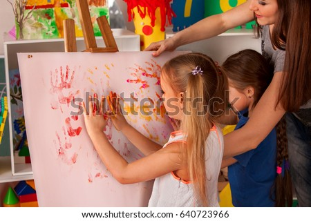 children painting finger on easel group of kids girl and boy with teacher learn paint - Pictures Of Kids Painting