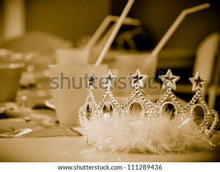 Children party sepia background with young princess crown - stock photo