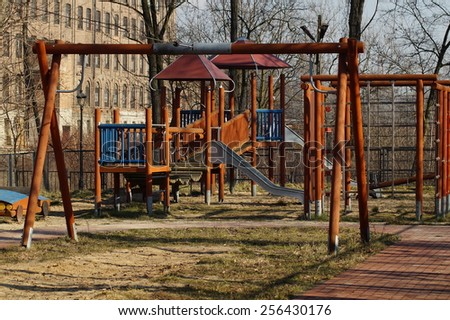 Children play area - wooden toys outdoor - stock photo