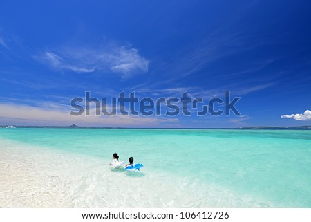 Children play at the beach - stock photo