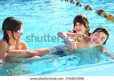 children play in open air swimming pool in egyptian resort hotel