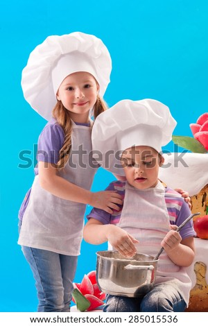 Children play in the cook - stock photo