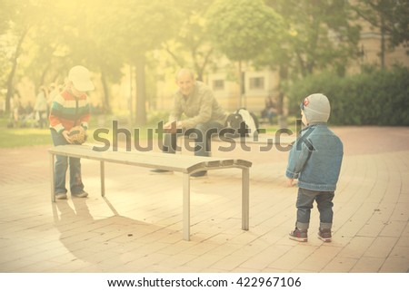 Children play in the park a sunny day - stock photo