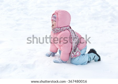 Children play outdoors in snow. Little girl enjoying a winter. Kids sled in the Alps mountains in winter. Outdoor fun  - stock photo