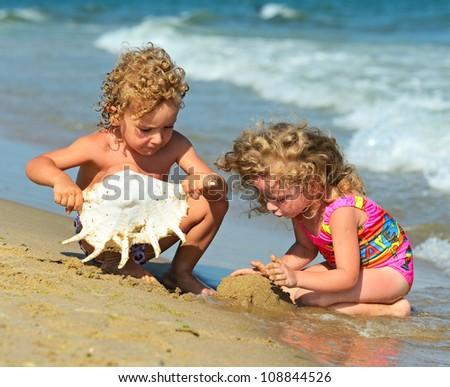 Children play the seashore - stock photo
