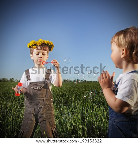 children play with ship outdoors - stock photo