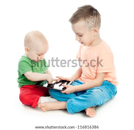 children play with the tablet computer - stock photo