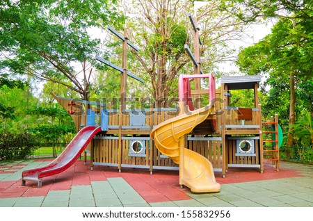 Children playground equipment in the form of pirate ship at the park. - stock photo