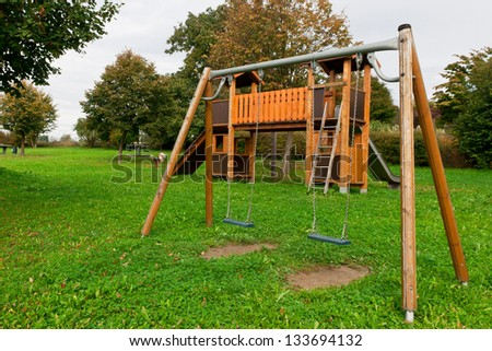 Children playground with green surroundings nobody - stock photo