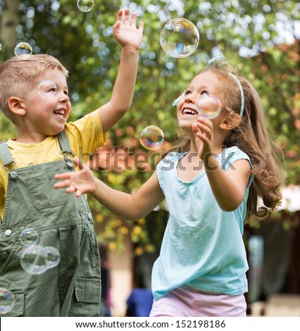 Children playing at the garden - stock photo
