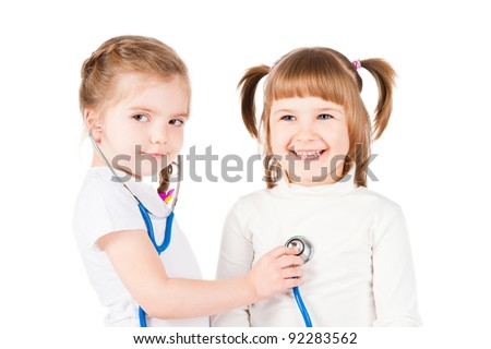 Children playing doctor, isolated on white - stock photo