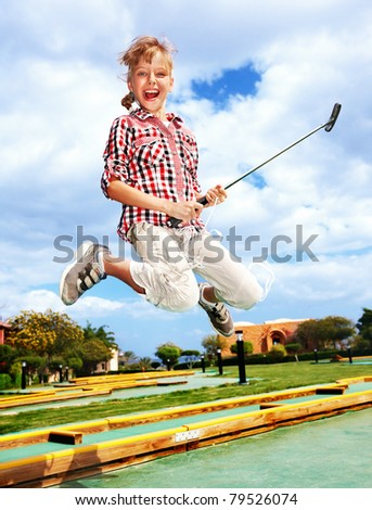 Children playing golf in park. Outdoor. - stock photo