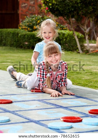 Children playing in golf. Kids outdoor games.