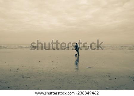 Children playing in the beach fun. motion blur - stock photo