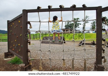Children playing in the playground equipment in the park