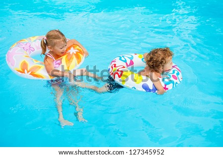 children playing in the pool - stock photo