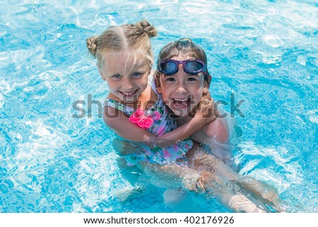Children playing in the pool fun and enjoy  - stock photo