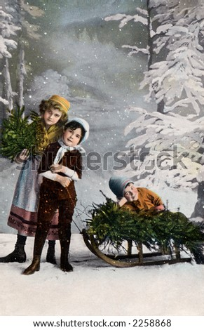 Children playing in the snow - a circa 1906 vintage hand-tinted photograph (studio set-up with a painted backdrop and fake snow falling).