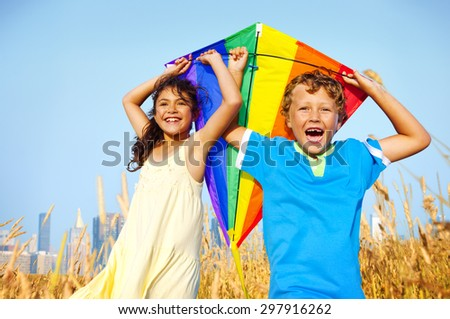 Children Playing Kite Happiness Cheerful Summer Concept - stock photo