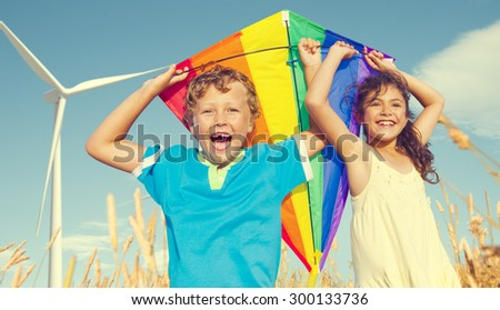 Children Playing Kite Happiness Cheerful Summer Concept - stock photo
