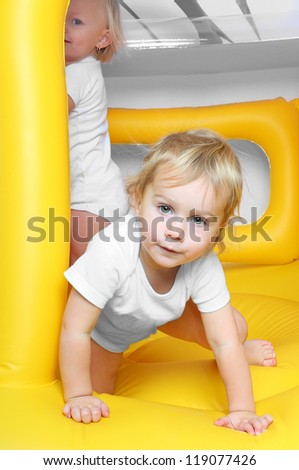 Children playing on a inflatable trampoline.