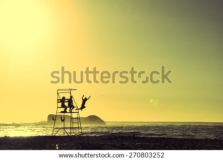 Children playing on a lifeguard chair - Cape Town - stock photo