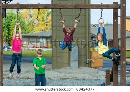 Children playing on a school playground during recess. - stock photo