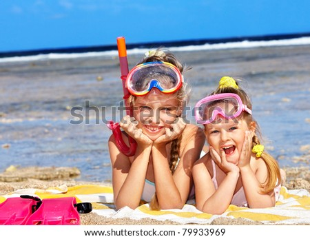 Children playing on  beach. Snorkeling. - stock photo