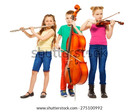 Children playing on musical instruments together - stock photo