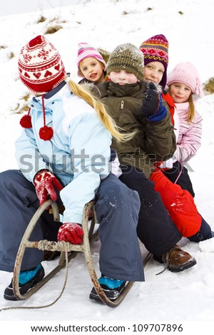 Children playing on the snow - stock photo