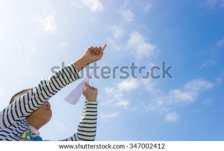 Children playing paper airplane. - stock photo