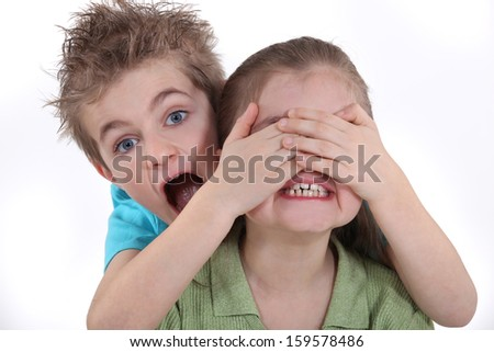 Children playing peek-a-boo - stock photo