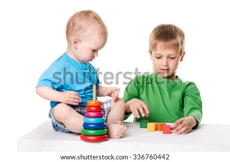 children playing together on white background - stock photo