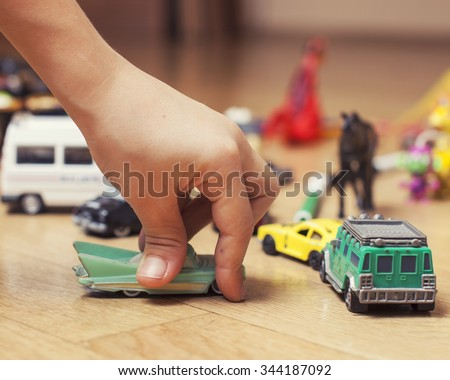 children playing toys on floor at home, little hand in mess, free education - stock photo