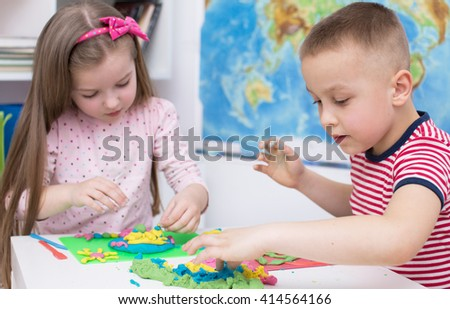 children Playing with Color Play Dough